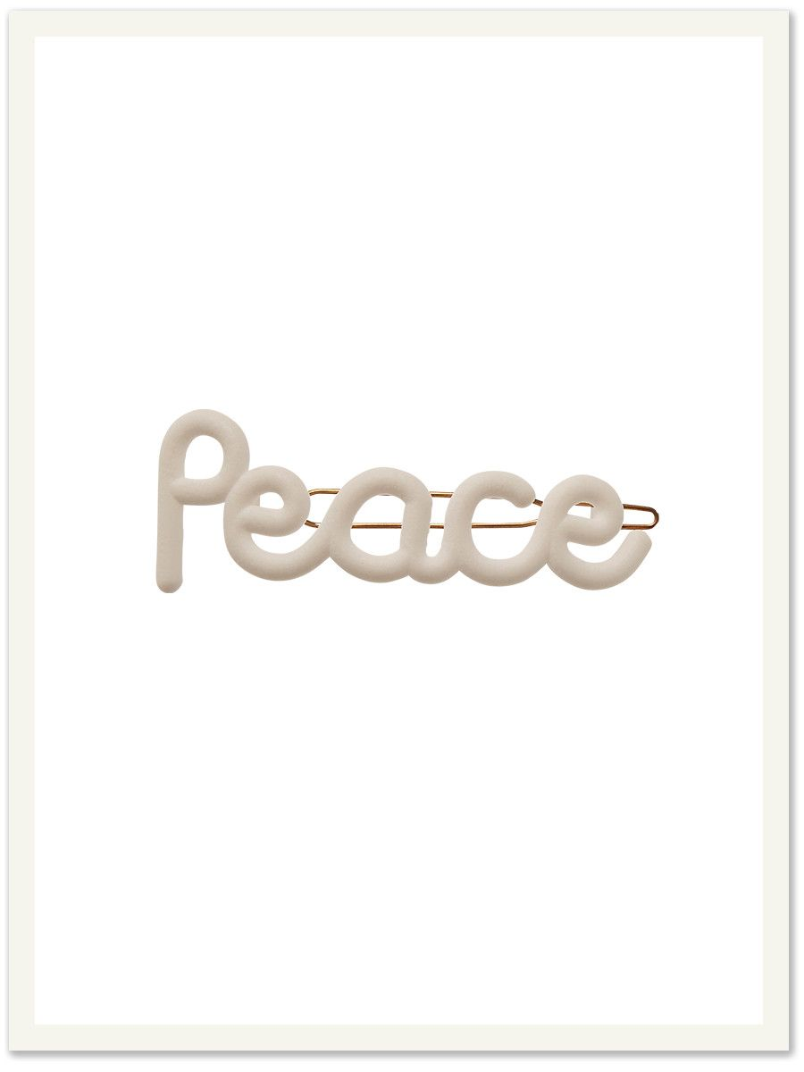 White hair clip that says 'Peace', as shown in Vogue girl Japan.
